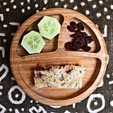 """Lunch: PB&J on sourdough bread, raisins, and cucumber."""