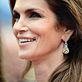Cindy Crawford wore Chopard yellow diamond earrings.