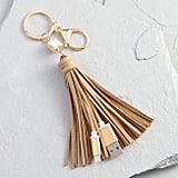 World Market Gold iPhone Charger Tassel Keychain