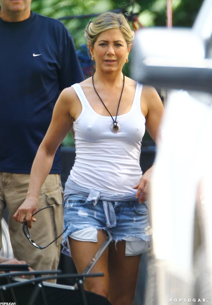 Jennifer Aniston arrived to the Wilmington, NC, set of We're The Millers in very short shorts and a simple white tank top yesterday. The Summer look is classic Jennifer, who is forever the quintessential t-shirt and jeans girl. When it came time to film, however, Jennifer was back in her character's more conservative wardrobe, once again consisting of capri-length khakis and a sleeveless button-down shirt. Jennifer has been in North Carolina working on the film for the past few weeks alongside costars Jason Sudeikis, Emma Stone, and Kathryn Hahn. In the movie Jennifer plays a prostitute who agrees to pose as Jason Sudeikis's character's wife to help him smuggle drugs into the country.  While Jennifer is off working, her man is currently cleaning up in our 2012 Shirtless Bracket. Justin Theroux's amazing six-pack has him currently in 11th place overall, though it may be hard to unseat the current frontrunner: Robert Pattinson.