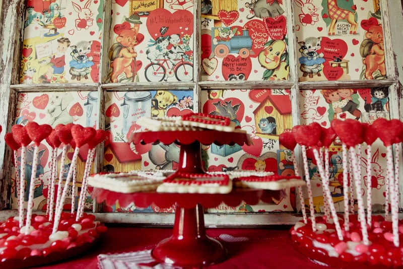 The sweets station had guests seeing red: candies, cookies, and vintage Valentine's Day posters.  Source: Jenny Cookies