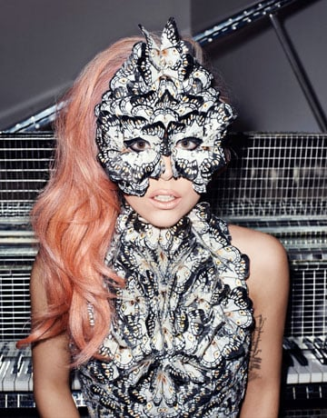 A specially made Alexander McQueen dress and mask make for a fabulously feathered ensemble.