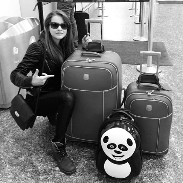 Model Barbara Palvin traveled in a black-on-black ensemble and showed off her fun panda luggage. Source: Instagram user barbarapalvin_