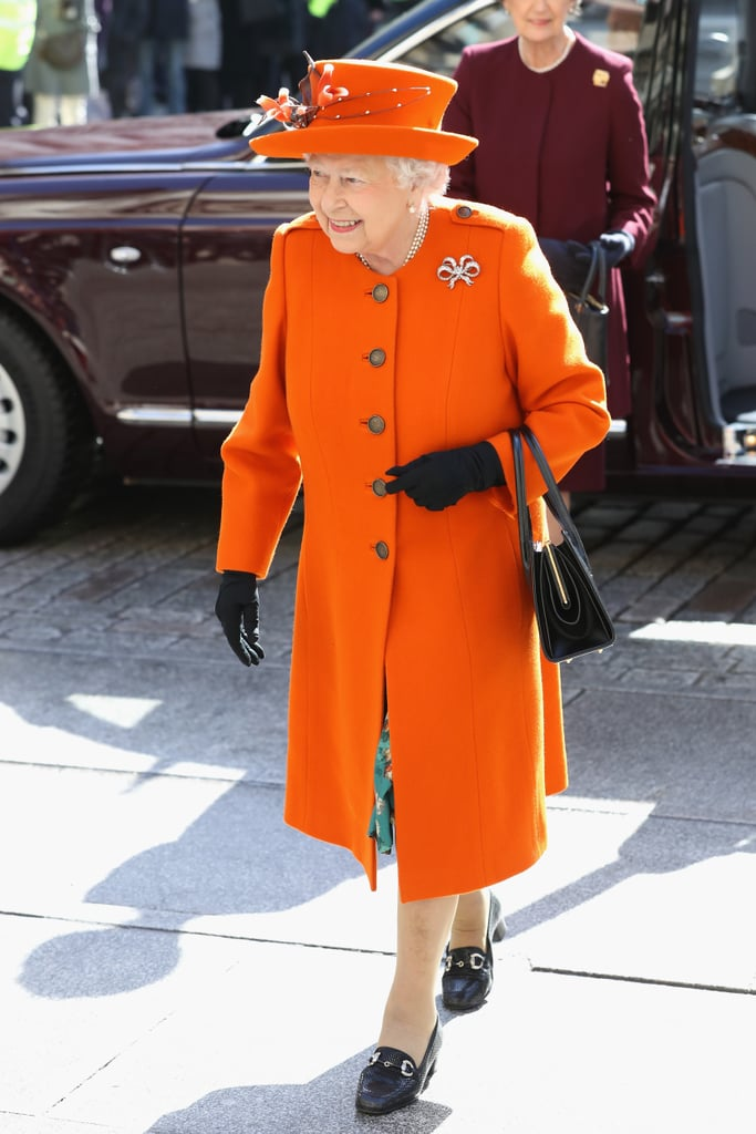 Earlier that month, she wore them with a bright orange coat.