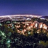 The ultraprivate 2.5-acre Hollywood Hills property affords sweeping city, canyon, and mountain views.