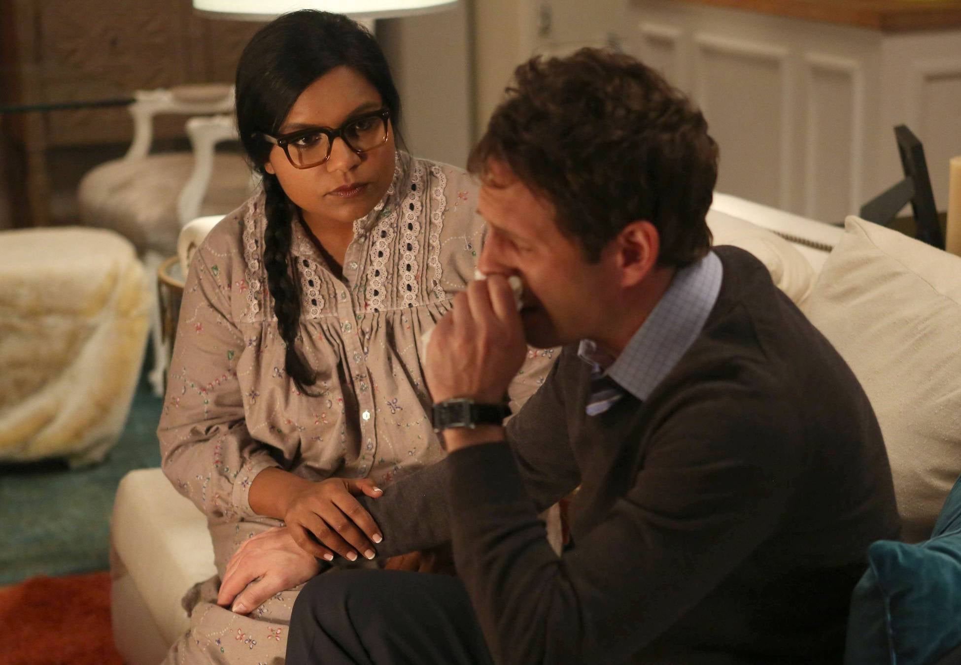 Mindy comforts Cliff while he grieves for his grandmother.