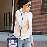 Her Loose-Fitting White Blouse Was 1 Gust of Wind Away From a Slippage