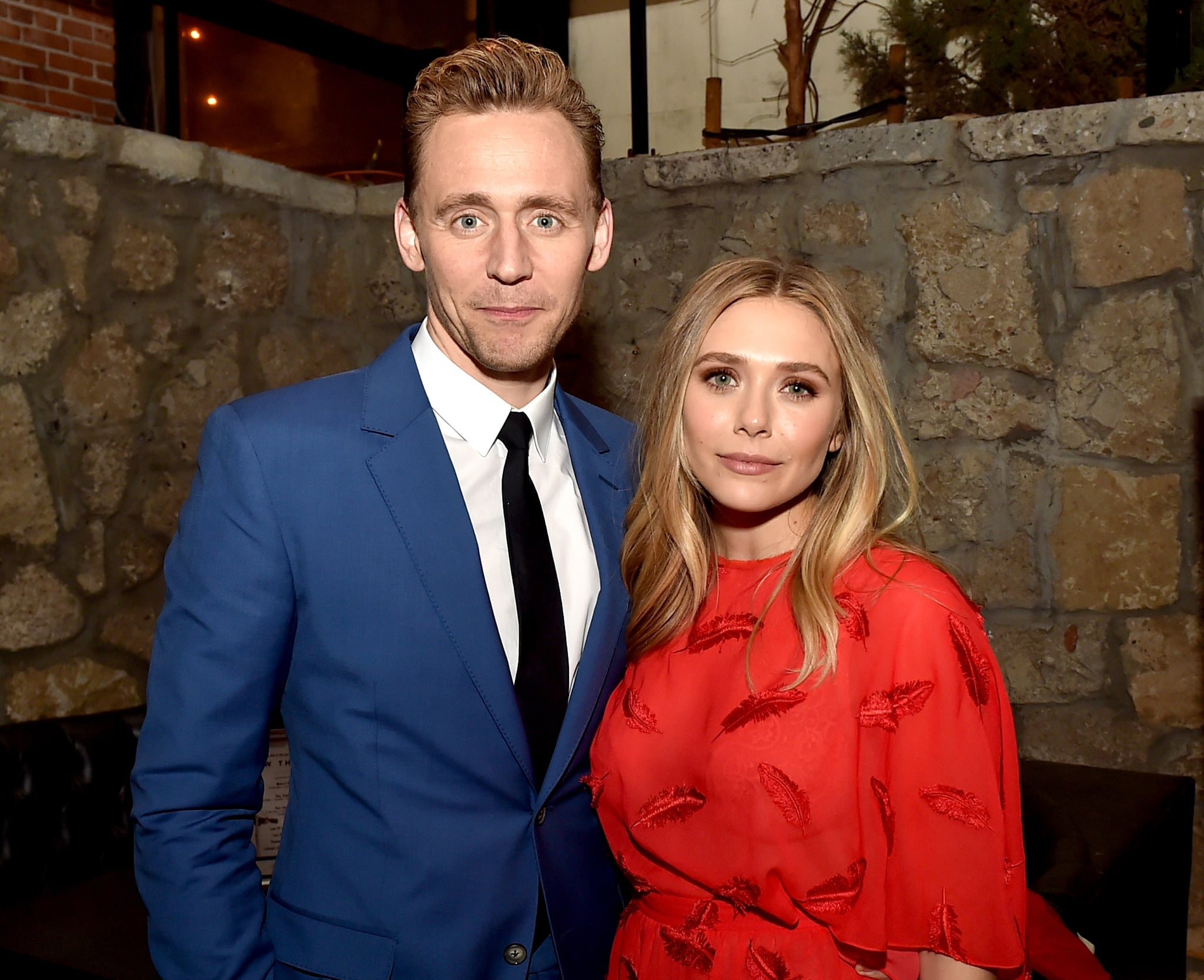 LOS ANGELES, CA - MARCH 22:  Actors Tom Hiddleston (L) and Elizabeth Olsen pose at the after party for the premiere of Sony Pictures Classic's