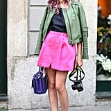 We love the juxtaposition between the bright girlie pink and more neutral olive leather. Source: Greg Kessler