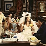 But secretly we hope she pulled out Rachel Green's poofy number — complete with that '80s-style veil.