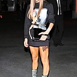 At the Givenchy show, Anna Dello Russo accented her mini with striped boots.