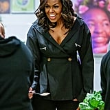 While visiting the Lower Eastside Girls Club for a meet-and-greet in New York, Michelle wore a peplum top with skinny jeans and By Far boots.