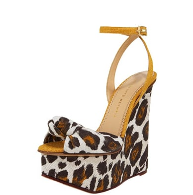 Notice how the wild leopard print and sky-high wedge are tempered with a sweet bow and delicate ankle strap. Charlotte Olympia Leopard-Print Linen Wedge Sandal ($895)