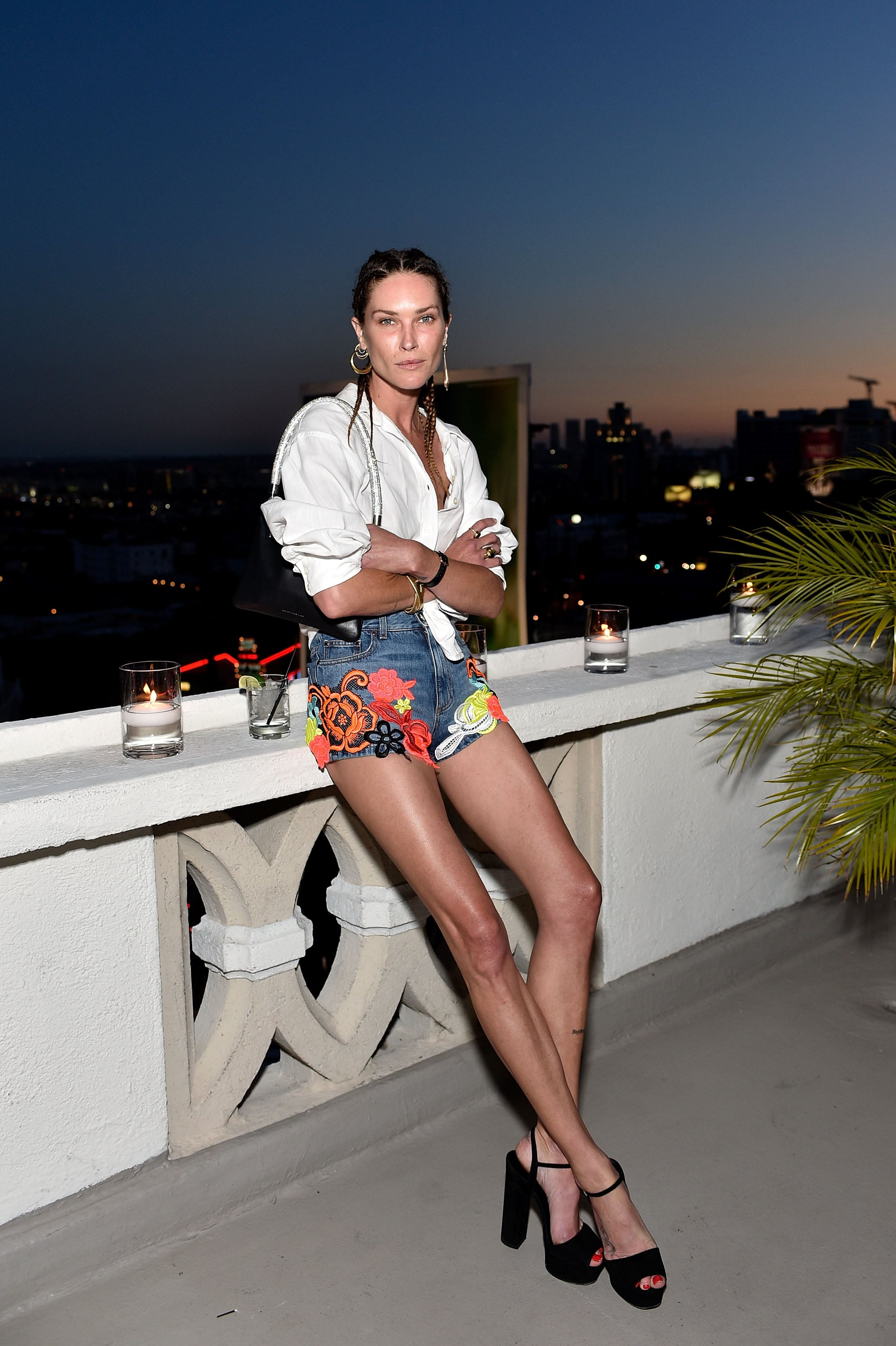 We'll never tire of denim staples, but we have to hand it to Erin Wasson for her fresh, floral-embroidered pair. They're the perfect contrast to a classic button-up.