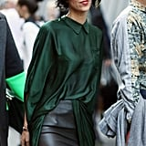 A collared emerald green blouse sweetens the deal on a leather pencil skirt.