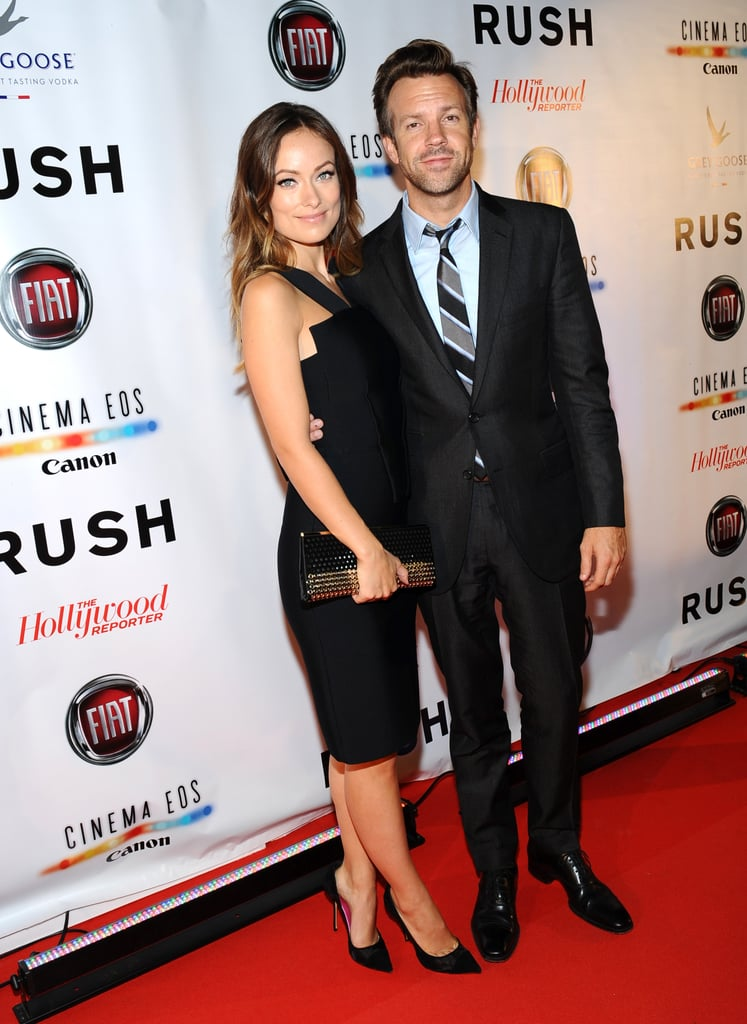 Olivia Wilde and Jason Sudeikis stayed close on the red carpet at the Toronto International Film Festival premiere of Rush in September 2013.