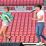 Taylor rehearsing witih Niall Horan in the Madewell High-Rise Denim Shorts in Posey Wash.