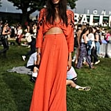 This colorful orange Free People dress was made to stand out from the crowd.