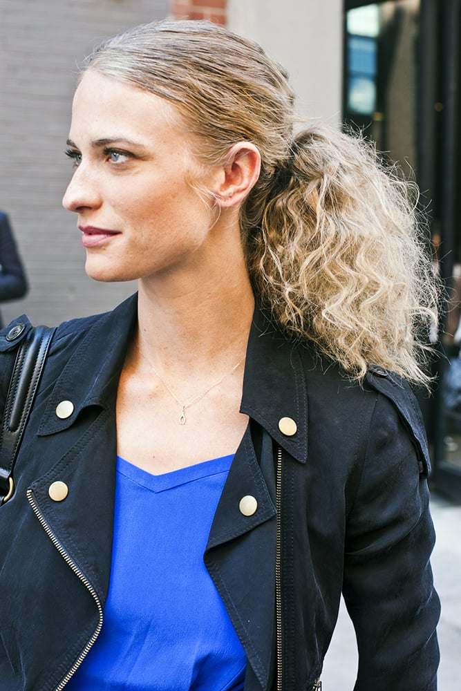 Tease to your heart's desire — or just let the humidity do its thing — to achieve this incredibly gorgeous, fluffed-up ponytail. Photo by Caroline Voagen Nelson