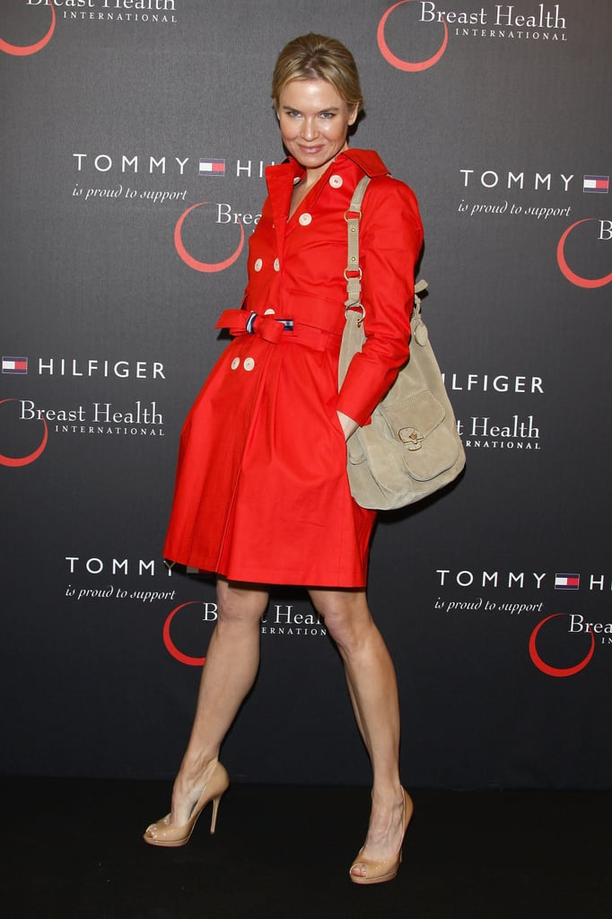 Renée Zellweger stepped out in Milan today at the launch of Tommy Hilfiger's new, limited-edition handbag, which was designed to support Breast Health International. It was the actress's first public event since her split from Bradley Cooper was announced, and she looked chic in a red trenchcoat worn over a green dress as she arrived. Later, the Carolina Herrera spokesmodel changed into a strapless, purple number for a press conference to spotlight the new purse. Renée made her way to Italy for today's event after spending time among some famous friends as a guest at Reese Witherspoon's wedding less than two weeks ago.