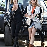 Kate Moss and Stella McCartney buddied up to check out the shows. Kate was glam rock in all black and a metallic cardigan, while Stella showed off her sporty side in a black-and-white bomber jacket.