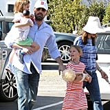Ben Affleck held on to his girls, Violet and Seraphina, while out in LA at the Brentwood Country Mart.
