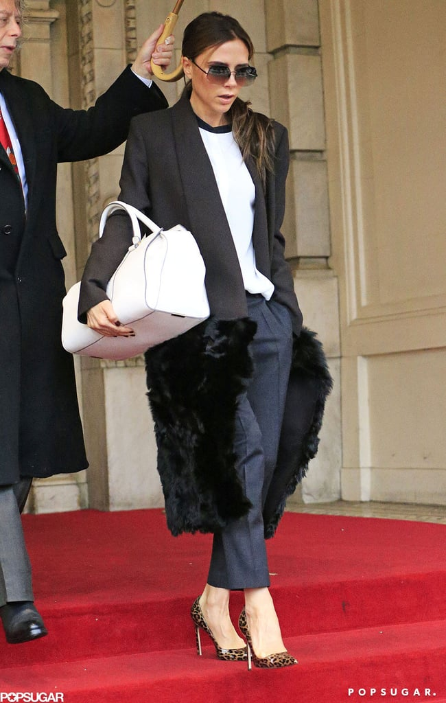 Victoria Beckham wore her hair in a low ponytail.