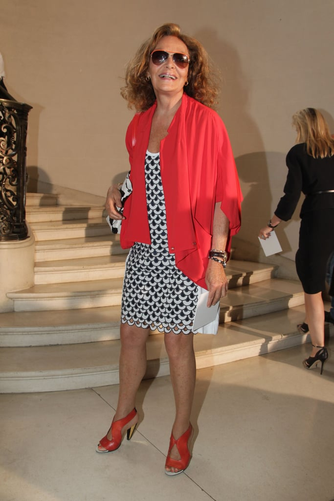 Diane von Furstenberg arrived in a silky red jacket over her own printed dress at Christian Dior.