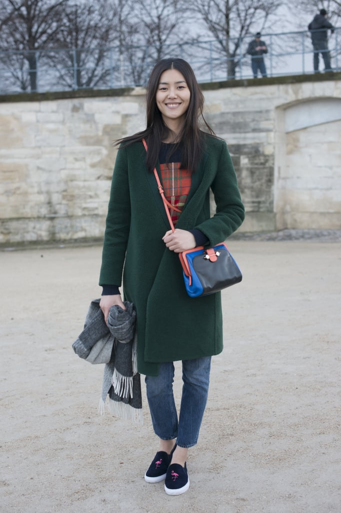Liu Wen looked casual-cool in an outfit that felt totally relatable to the every girl. She wore loose jeans with a forest-green coat, a bright crossbody bag, and skater sneakers printed with a cute flamingo.
