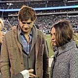 Mila Kunis and Ashton Kutcher hung out on the field at the NY Jets game.