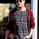 Ryan Gosling wore sunglasses and a crimson cardigan as he strolled around NYC.