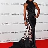 Kelly Rowland wore a silk Maria Grachvogel halter-style black and white gown with train.