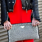 Prada's oversize woven tote was a stunning accompaniment to this red and black ensemble.