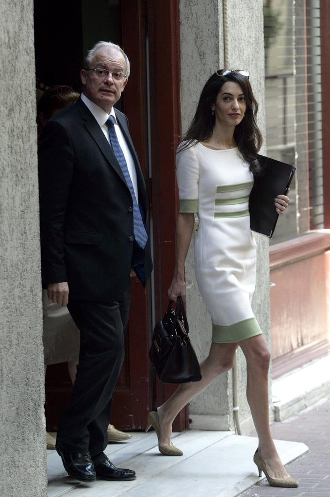 What, you thought Amal Alamuddin was going to go Hollywood after marrying George Clooney? The British human rights lawyer — and new Mrs. Clooney — was back at work this week, traveling to Athens, Greece, to help negotiate the transfer of the Pantheon Marbles from the British Museum back to Greece. Amal was seen attending several meetings on Tuesday and happily chatting with the Greek Minister of Culture Konstantinos Tasoulas. Amal and George got married in a luxurious ceremony in Italy on Sept. 27 and reportedly spent their honeymoon at their new home in England. Of course, George has been busy with work of his own after his wedding, including unveiling the Tomorrowland trailer during a surprise appearance at New York Comic-Con last week.