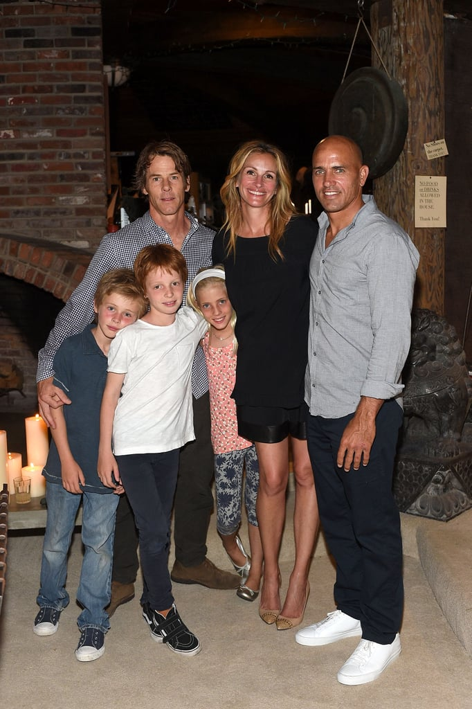 Julia was all smiles with her husband, Danny Moder, and their three kids as they joined surfer Kelly Slater for a charity event in August 2015.
