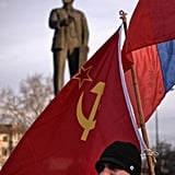 Pro-Russia residents also made their voices heard. In Simferopol, the capital of Crimea, a man held the flags of the Russian Federation and Soviet Union during a Saturday demonstration in the city's Lenin Square. Historically, the Crimean peninsula has changed hands many times, and it was a key part of the Soviet Union. But following the collapse of the USSR, it became part of independent Ukraine.
