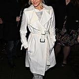 Outside, Julianne covered up her Georges Hobeika outfit with a chic white trench coat.
