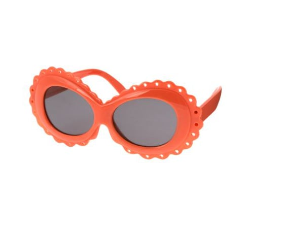Bright orange and scalloped detail give these sunglasses ($5, originally $11) a bit of an edge.