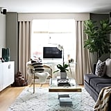 Lacking sufficient closet space (a common story in small, city apartments), Victoria created 140 inches of storage by lining up three Ikea Besta floating cabinets under the TV.