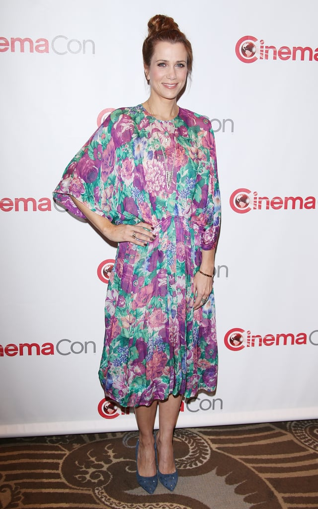 Kristen Wiig's floral midi-length dress and blue studded pumps livened up CinemaCon in Las Vegas.