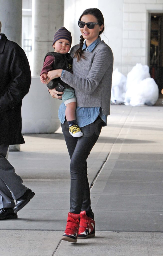 Miranda Kerr held onto Flynn.