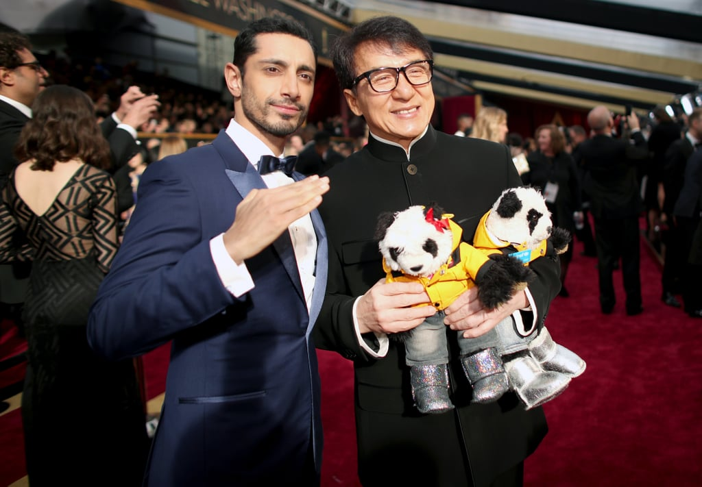 Riz Ahmed finished his amazing award season run with a memorable appearance at the Oscars on Sunday night. Last time we saw the actor/writer/rapper he was inspiring us with his winning speech at the SAG Awards, but this time around, he was on presenting duties with Felicity Jones. Looking dapper in a blue Ermenegildo Zegna Couture tux, Riz hit the red carpet in serious style, and wasted no time in hunting down Jackie Chan for a photo opp. If you thought 2016 was a big year for the Rogue One star, just wait to see how he dominates 2017!