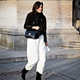 For French-girl chic, tuck a longer pair of wide-leg pants into your boots.