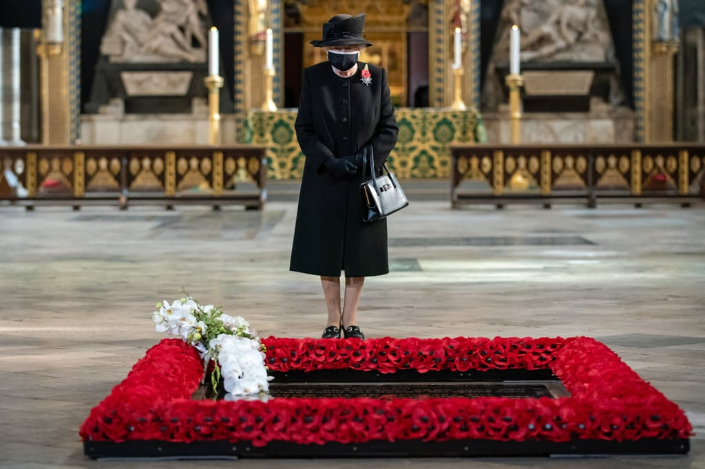 "On Nov. 8, the royal family came together for the annual Remembrance Sunday service at the Cenotaph in London. With many of the royal family's public events canceled this year due to the coronavirus pandemic, Remembrance Sunday marks the first time we've seen the queen and the other members together since the Commonwealth Day service in March. Held on the second Sunday of November each year, Remembrance Sunday is a time for people to honor those who have suffered and died at war.  For the first time in history, the service itself took place behind closed doors this year due to the coronavirus pandemic. However, the royal family still took part in the two minutes of silence followed by wreath-laying at the foot of the Cenotaph — an annual tradition that this year was closed to the public and rather broadcast live, with people encouraged to take part in the two-minute silence at home. During the socially distanced ceremony, Prince William, Princess Anne, and the Earl of Essex all laid wreaths at the Cenotaph, as did Prince Charles, who laid a wreath on behalf of his mother, the queen. Prime Minister Boris Johnson, who was accompanied by fiancée Carrie Symonds, and Labour Party leader Keir Starmer also laid wreaths. Due to social-distancing measures, the rest of the family were not able to watch the wreath-laying all together. Instead, they stood in pairs separated across three balconies of the Foreign, Commonwealth, and Development Office building. Queen Elizabeth II looked down on the proceedings from the middle balcony accompanied by her lady-in-waiting Mrs. Susan Rhodes; Camilla, Duchess of Cornwall, and Kate Middleton stood to the queen's right; and Sophie, Countess of Wessex, watched from the third balcony to the queen's left with Princess Anne's husband, Sir Timothy Laurence.  Prince Harry and Meghan Markle were not in attendance, as they have stepped down as working members of the royal family and are currently living in California. However, that didn't stop the Duke of Sussex from honoring the important day in his own way. The former member of the British Armed Forces made a surprise appearance on a military podcast called Declassified, which had a Remembrance Day special episode. Speaking alongside other veterans, Prince Harry said, ""Being able to wear my uniform, being able to stand up in service of one's country, these are amongst the greatest honours there are in life. To me, the uniform is a symbol of something much bigger; it's symbolic of our commitment to protecting our country, as well as protecting our values. These values are put in action through service, and service is what happens in the quiet and in the chaos."" Ahead of the wreath-laying, the queen — spotted wearing a mask in public for the first time — took part in a brief ceremony inside Westminster Abbey to commemorate the 100th anniversary of the interment of the Unknown Warrior. See more photos from the royals' appearance ahead."