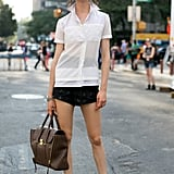 A 3.1 Phillip Lim bag added polish to shorts and sandals.