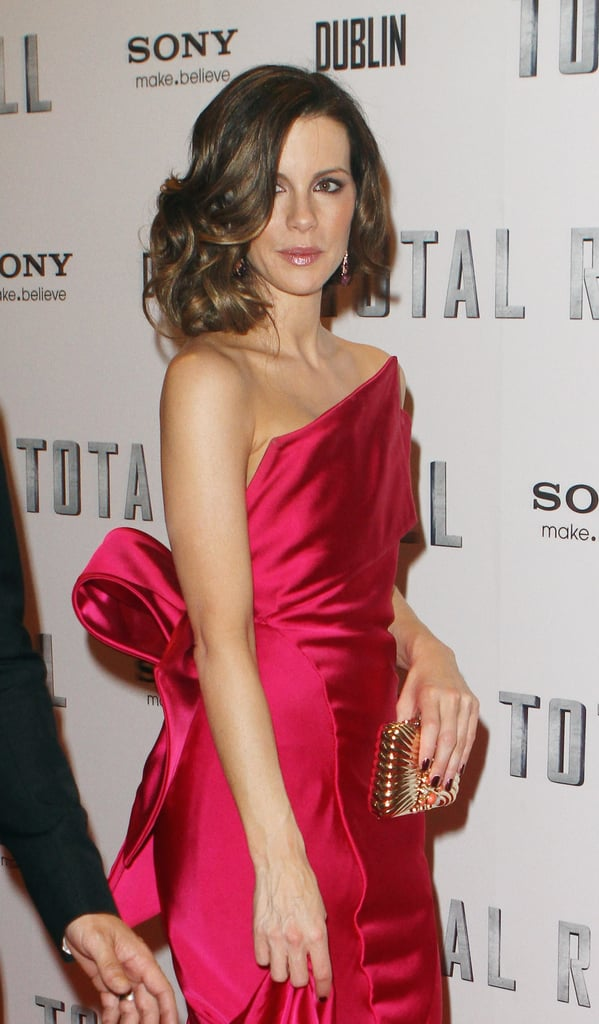 We caught a glimpse of the dramatic bow detail on the back of Kate's Donna Karan gown. She finished off her pretty pink look with a Judith Leiber clutch, Graziela earrings, a loose-wave updo, and soft makeup.