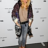 Sienna Miller cozied up in an oversize cardigan at the London premiere party.