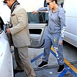 Jennifer Lopez followed manager Benny Medina out to their car.