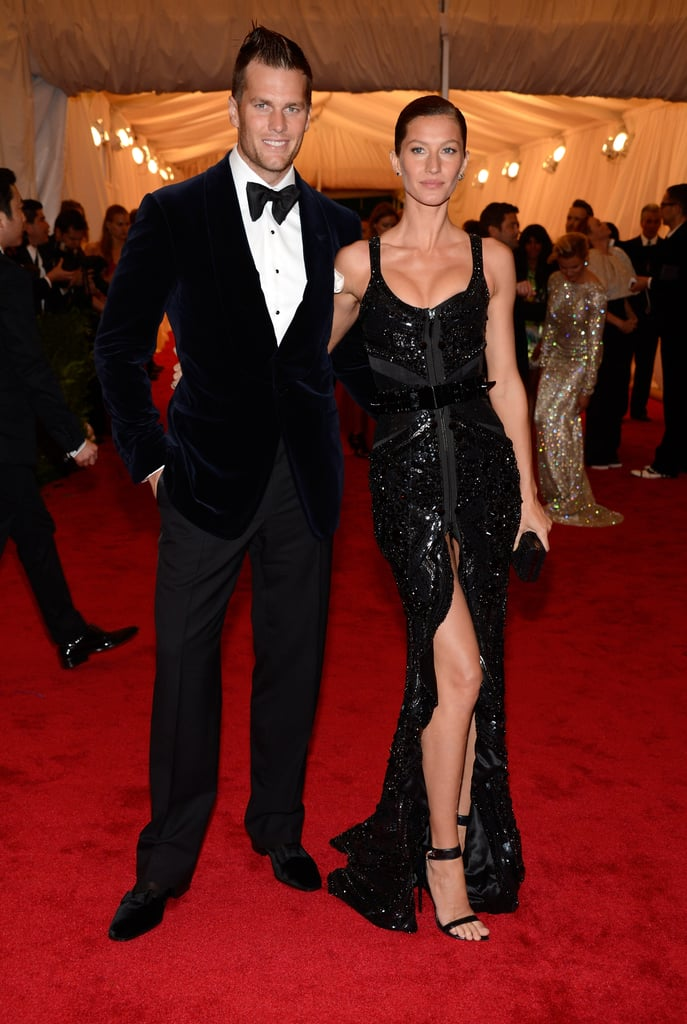 Gisele Bundchen and Tom Brady once again brought the heat to the annual Met Gala in NYC this evening. The handsome couple posed together, with Tom showing off the fresh haircut he recently debuted and Gisele sporting a glow from her latest bikini shoot. Gisele was decked out in a dramatic Givenchy dress complete with a daring slit for the event. Tom cleaned up well himself in a Tom Ford suit. Tom and Gisele kissed for the cameras, proving that they're once again in the running for king and queen of fashion's biggest night. The two have been hanging out in NYC for the past few days and were spotted out on PDA-filled dates in the city.   Check out all the Met Gala red carpet pictures and weigh in on all the looks with their live Met Gala fashion polls.