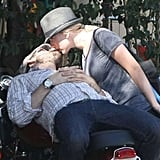 Scarlett and Ryan Reynolds shared a sexy smooch on a motorcycle in 2008.